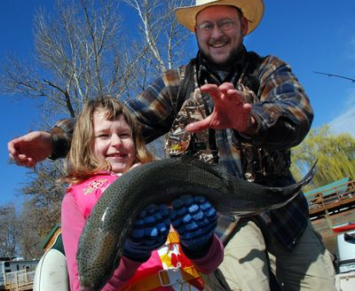 Addy Albrecht had her hands full after landing this big rainbow at Williams Lake. (Rich Landers)