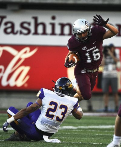 Montana wide receiver Jerry Louie-McGee  hurdles Northern Iowa defensive back A.J. Allen  during Saturday's game in Missoula. (Colter Peterson / AP)