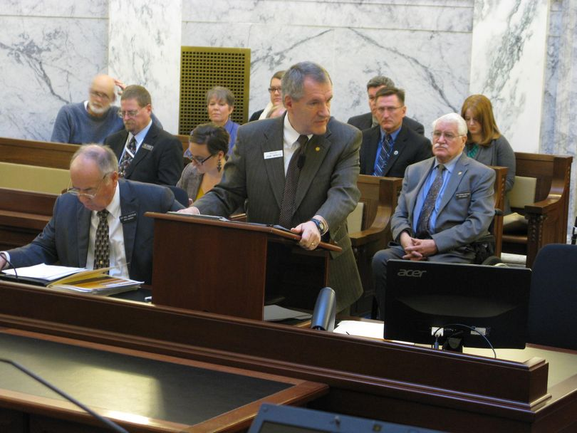 Sen. John Tippets, R-Montpelier, pitches a state employee pay raise plan to the Legislature's joint budget committee on Friday, after he chaired a special committee that unanimously backed the plan; at right is House Commerce Chairman Stephen Hartgen, R-Twin Falls. (Betsy Russell)