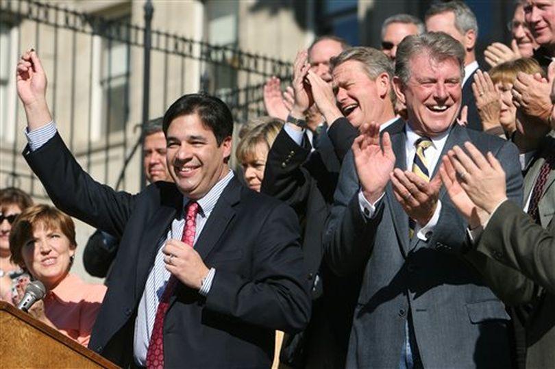 Idaho Republican Congressman-elect Raul Labrador, left, holds up his