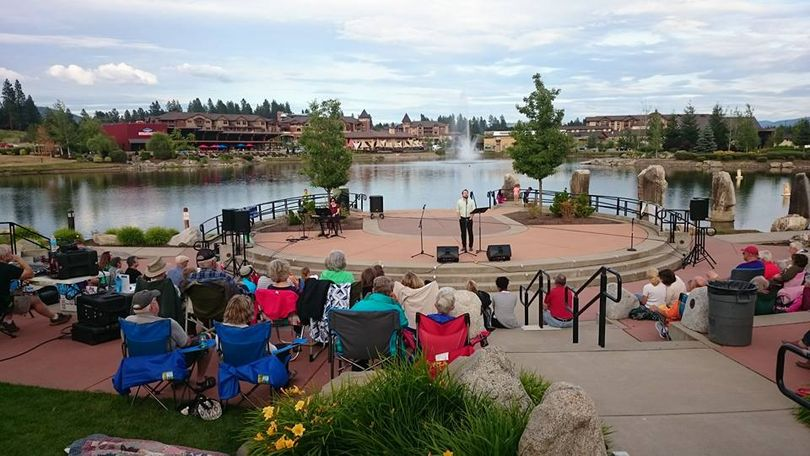 Christian Duhamel performs at the microphone during an evening of show tunes by Coeur d'Alene Summer Theatre actors for the Coeur d'Alene Arts & Cultural Alliance Summer Concert series at Riverstone Pond. If you look closely, you might find your Huckleberry Hound in the crowd. (Paul Amador/Facebook photo)