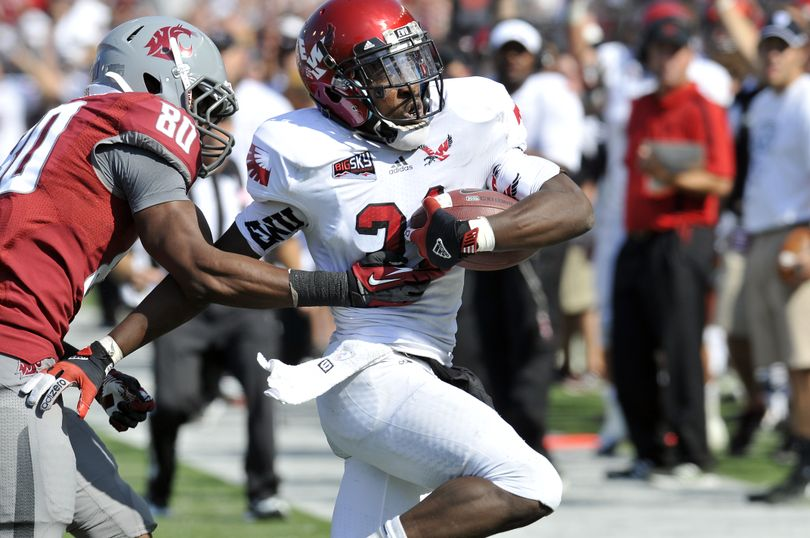 Eastern Washington's T.J. Lee, right, intercepts a ball intended for Washington State's Dominique Williams (80) in the fourth quarter Saturday, Sept. 8, 2012 at Martin Stadium at WSU.  The Cougars won 24-20. (Jesse Tinsley / The Spokesman-Review)