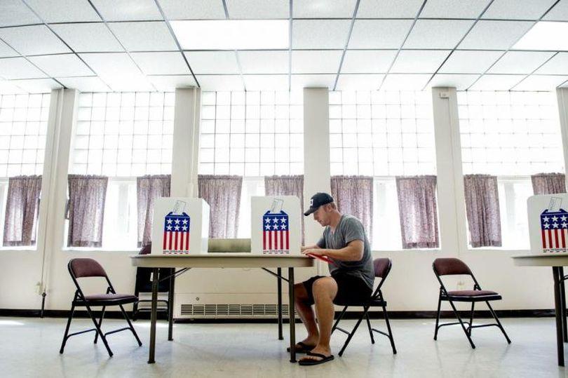 Jon Larson votes in the Idaho Primary Election at St. Thomas Center in Coeur d'Alene, Idaho, on Tuesday, May 17, 2016. (Kathy Plonka / The Spokesman-Review)