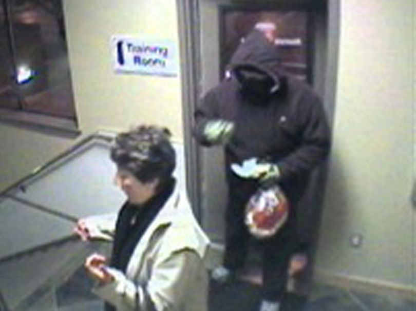 An unidentified person was caught on video in a robbery Tuesday morning December 22, 2009 at Mountain West Bank.  Courtesy of Coeur d'Alene Police Department (Courtesy Police / The Spokesman-Review)
