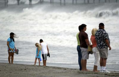 Beachgoers look at the churning surf at Atlantic Beach, N.C., Saturday. A hurricane watch was posted for the Southeast coast as Ophelia strengthened into a hurricane once again.  (Associated Press / The Spokesman-Review)