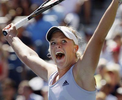 Melanie Oudin celebrates her victory over Elena Dementieva. (Associated Press / The Spokesman-Review)