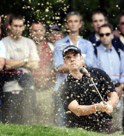 Ireland's Paul McGinley plays out of a bunker during the first round of his final against New Zealand's Michael Campbell.   (Associated Press / The Spokesman-Review)