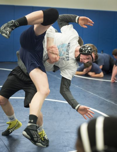 Central Valley High School senior David Shepard, practices with teammate Ben Hisel (behind) Monday. (Colin Mulvany)