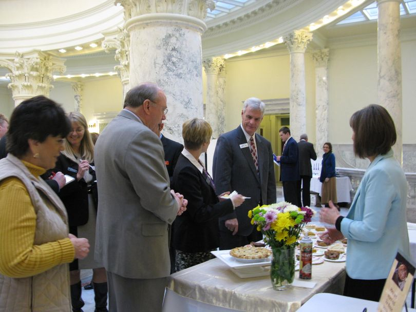 Lawmakers and others sample homemade pie at the Idaho Home Educators Coalition's annual