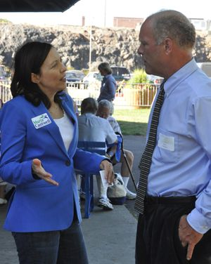 U.S. Sen. Maria Cantwell offers some campaign advice to Daryl Romeyn, a Democrat running for Spokane County commissioner, at the Spokane County Democratic Party's fund-raiser Saturday in Riverfront Park. (Jim Camden)