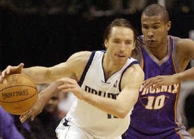 Steve Nash has agreed to a five-year deal with the team that drafted him – the Phoenix Suns.  (Associated Press / The Spokesman-Review)