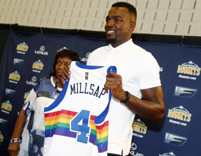 Denver Nuggets new forward Paul Millsap holds up his new jersey during his introduction to the media at a news conference Thursday, July 13, 2017, in Denver. (David Zalubowski / Associated Press)