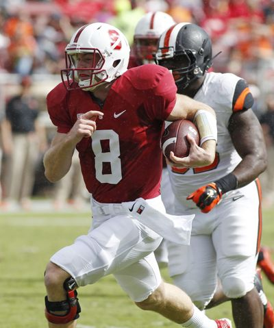 Stanford quarterback Kevin Hogan runs in for a touchdown against Oregon State during the first half. (Associated Press)