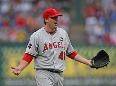 Angels pitcher John Lackey reacts to being ejected.  (Associated Press / The Spokesman-Review)