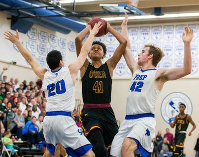O'Dea's Paolo Banchero (41) draws a crowd of defenders against Seattle Prep in a Feb., 2018, game. (Courtney Pedroza / Seattle Times)