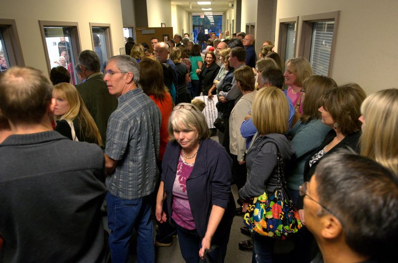 With a crowd spilling into the hallway, hundreds of citizens showed up at Tuesday's Spokane Valley City Council meeting to voice their concern about the XXXtreme Espresso stand on Sprague Avenue near Pines Road. (Colin Mulvany)
