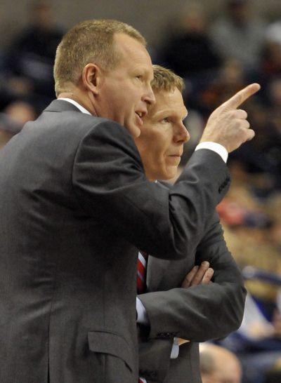 Gonzaga assistant Ray Giacoletti, left, puts his head together with head coach Mark Few. Giacoletti has accepted the head coaching position at Drake. (Jesse Tinsley)