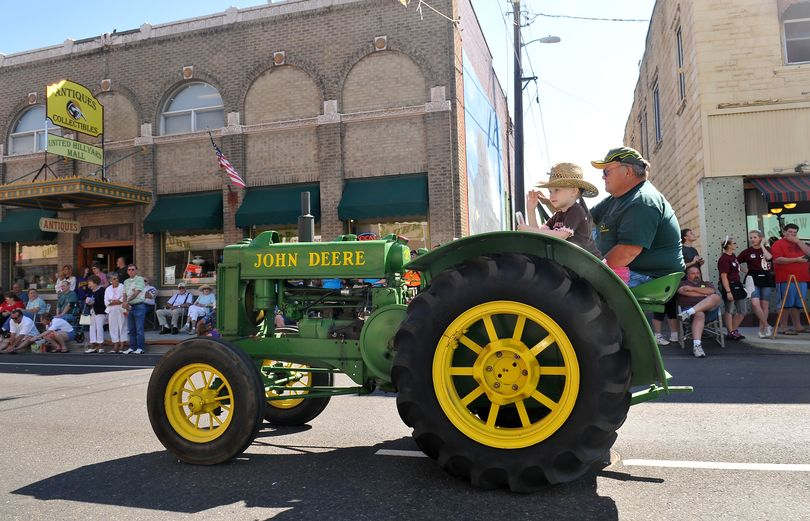 Greg Thomas, of Chattaroy, drives his 1937 John Deere tractor down Market Street in Hillyard with his granddaughter Lainee Shell, 5, in the Hillyard Hi-Jinks Parade on Saturday. The annual Hillyard Festival is celebrating its 100th incarnation. (Jesse Tinsley)