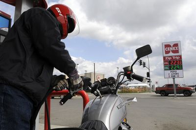 Jim Shaver, of Spokane Valley, fuels his motorcycle at the corner of Trent Avenue and Vista Road on Thursday.  Shaver says he gets 50 miles to the gallon.  (Dan Pelle / The Spokesman-Review)