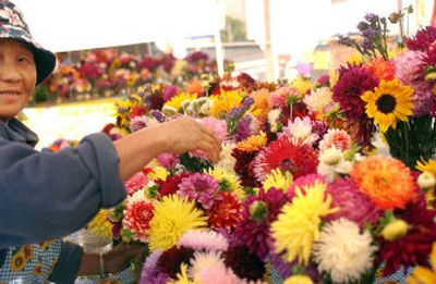 Sy Yang Lo, mother of Lylo Vu, owner of Lylo's Garden, arranges bouquets.   (Kathryn Stevens / The Spokesman-Review)