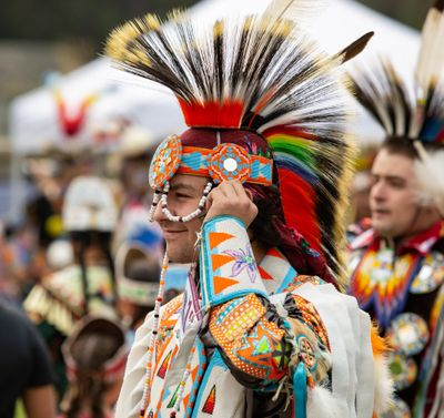 Alec Bluff smiles in his 2018 photo while dancing at the Gathering at the Falls powwow in Riverfront Park's Lilac Bowl. Bluff is of the Kalispel Tribe, which received a $700,000 grant from the U.S. Department of Justice to improve services for crime victims. (Libby Kamrowski / The Spokesman-Review)