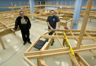 River City Modelers President John Langlot, left, and membership chairman Del Skobalski stand amid the framework for the club's new model train layout.   (Colin Mulvany / The Spokesman-Review)