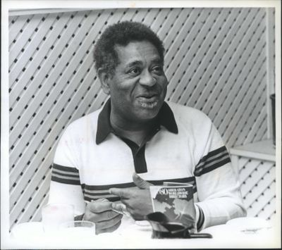 Dizzy Gillespie, one of the luminaries trapped in Spokane by volcanic ash, would rather have been home in New Jersey on May 19, 1980, but he was able to muster a smile during breakfast at the Sheraton-Spokane Hotel. (Don Jamison / The Spokane Daily Chronicle)