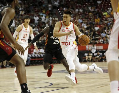 China's Zhao Rui (1) drives toward the basket past Miami Heat's Kendrick Nunn (25) during an NBA summer league basketball game Friday, July 5, 2019, in Las Vegas. (Steve Marcus / AP)