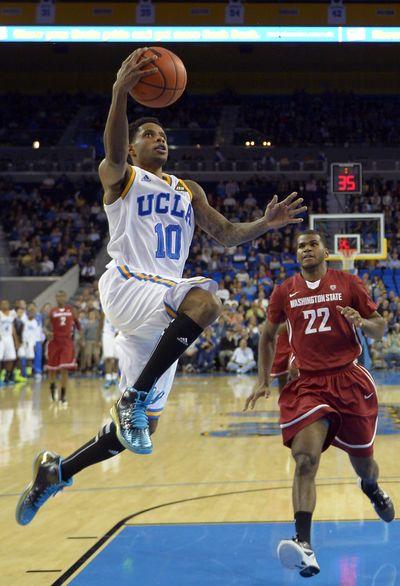 UCLA guard Larry Drew II (10) puts up a lay-in. (Associated Press)