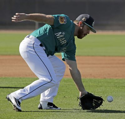 Seattle Mariners pitcher Shae Simmons participates in a drill during spring training baseball practice Wednesday, Feb. 15, 2017, in Peoria, Ariz. (Charlie Riedel / Associated Press)
