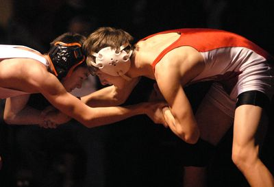 Garret Belgarde, right, of Sandpoint, tangles with Post Falls' Chad Booth in the 103-pound weight class finals  Dec. 20 during the annual Tri-State wrestling tournament at North Idaho College. Belgarde won by a pin.  (Jesse Tinsley / The Spokesman-Review)