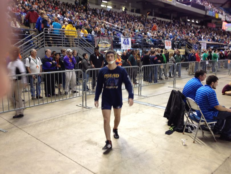 Chandler Rogers of Mead before quarterfinal match at 2012 state tournament.