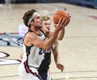Gonzaga guard Corey Kispert drives to the basket against Martynas Arlauskas during Kraziness in the Kennel on Nov. 12.  (By Dan Pelle / The Spokesman-Review)