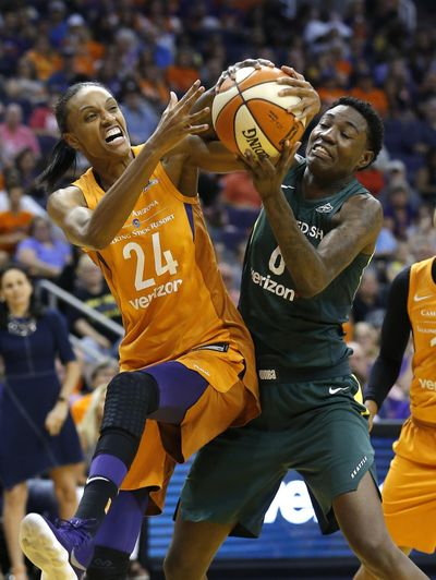 Phoenix Mercury forward DeWanna Bonner, left, battles Seattle Storm forward Natasha Howard for a rebound during the first half of Game 3 of a WNBA semifinal game Friday night in Phoenix. (Ross D. Franklin / Associated Press)