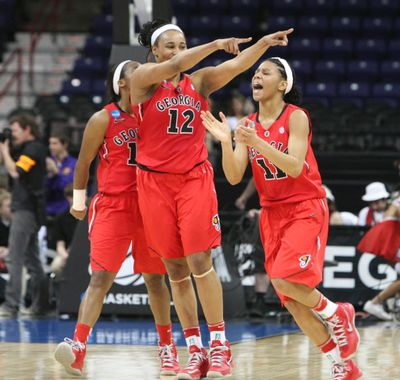 The Lady Bulldogs, including Jasmine Hassell, celebrates after defeating top-seeded Stanford at the Arena Saturday night. (Tyler Tjomsland)