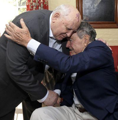 Former Soviet Union President Mikhail Gorbachev, left, and U.S. President George H.W. Bush meet Thursday. (Associated Press)