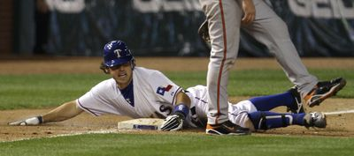 Rangers' Ian Kinsler, a former Spokane Indian, slides safely into third base for a triple to complete cycle.  (Associated Press / The Spokesman-Review)