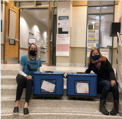 Western Washington University students Nathalie Wagler, left, and Adah Barenburg assisted students and members of the public who stopped by the campus Student Engagement Hub to vote on Election Day in November 2020.  (Courtesy of Nathalie Wagler)