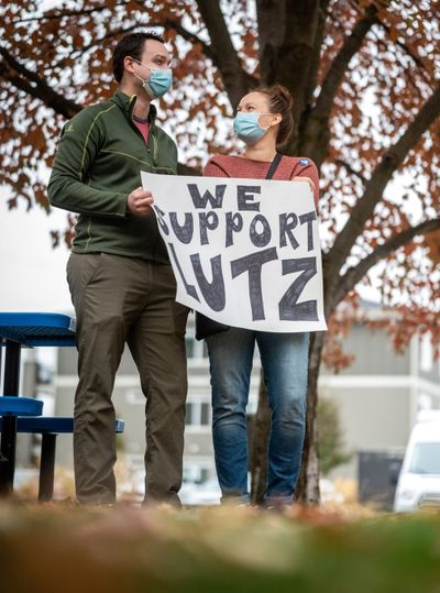 Before the Spokane Regional Health District Board of Health met virtually, Josh Hubbard, a physician and Chelsea Rasmussen a registered nurse attend a small rally Thursday in support of Health Officer Dr. Bob Lutz outside the Public Health Building.  (Colin Mulvany/THE SPOKESMAN-REVIEW)