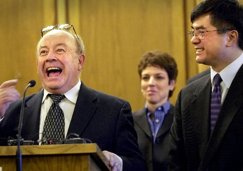 In this 2003 photo, Jerome Leveque shares a laugh during an announcement by hen-Gov. Gary Locke, right, that Leveque and private defense attorney Maryann Moreno, center, were the new Superior Court judges Friday. (Brian Plonka / The Spokesman-Review)