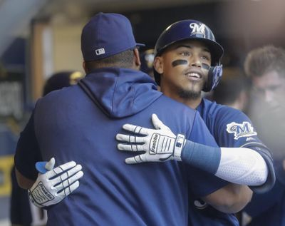 Milwaukee Brewers' Orlando Arcia, right, is congratulated by Jesus Aguilar after hitting a three-run home run during the fourth inning against the Seattle Mariners on Thursday in Milwaukee. (Morry Gash / AP)