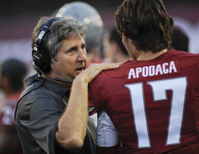If Cougars take a big lead, WSU coach Mike Leach, left, might get backup quarterback Austin Apodaca a few more snaps. (Associated Press)
