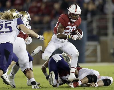 In this Nov. 10, 2017 photo, Stanford's Bryce Love (20) runs against Washington during the first half of an NCAA football game in Stanford, Calif. (Marcio Jose Sanchez / Associated Press)