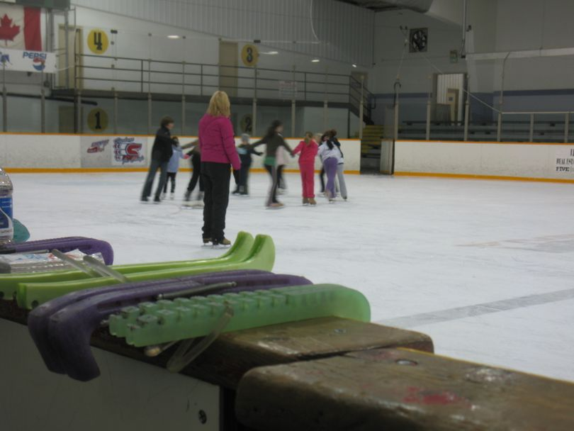 A local group of young figure skaters practices a routine for the opening ceremonies of the 2010 U.S. Figure Skating Championships as assistant choreographer Tera Caldera watches on at Eagles Ice Arena.