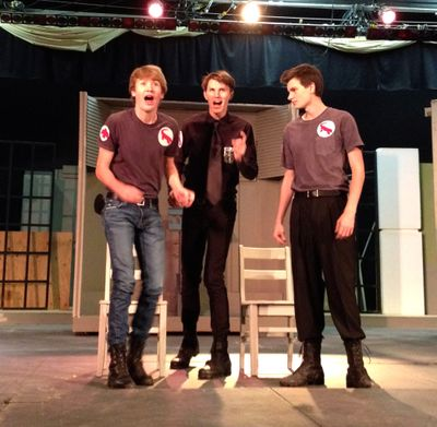 """From left, Jackson Bulger, Canyon O'Neil, and Caleb Patterson rehearse a scene in Gonzaga Prep's production of """"Fahrenheit 451."""""""
