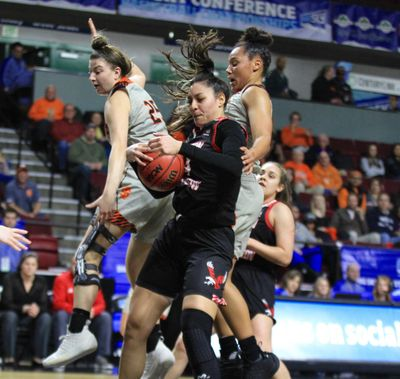 Eastern Washington forward Bella Cravens, center, fights for a rebound between two Idaho State defenders Tuesday at CenturyLink Arena in Boise. The Eagles upset the Bengals 67-65 in the Big Sky Conference Tournament quarterfinals. (Skyline Sports / Courtesy)