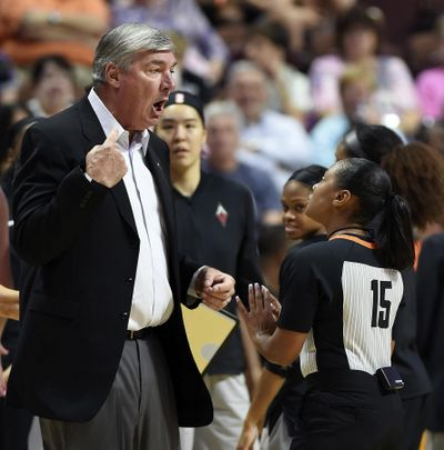 In this Sunday, Aug. 5, 2018, file photo, Las Vegas Aces head coach Bill Laimbeer, left, offers his opinion on a call to official Fatou Cissoko-Stevens during the first half of WNBA basketball game action against the Connecticut Sun in Uncasville, Conn. The WNBA has ruled that Las Vegas will forfeit its game against Washington that was canceled Friday night, Aug. 4, 20018, when the Aces players decided not to play because of concerns about their health and safety after 26 hours of travel. (Sean D. Elliot / Day via AP)