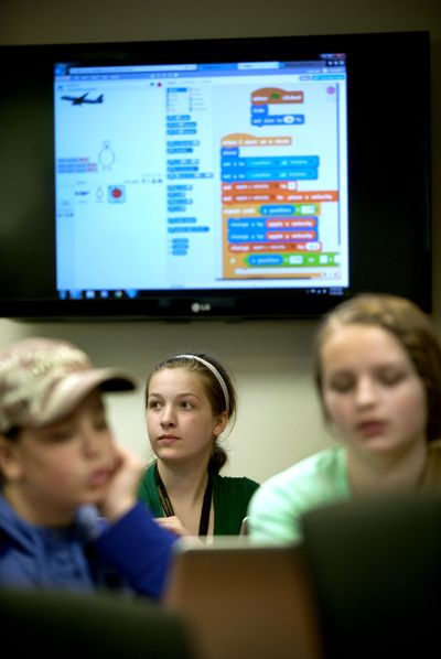 Rylie Rasmussen, 13, center, of Hayden, participates Thursday in University of Idaho's software coding camp for middle school girls at the Coeur d'Alene campus. (Kathy Plonka)