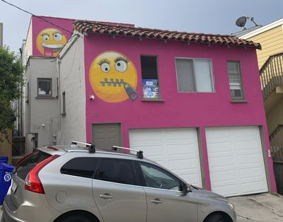 Painted emoji are seen on a house in Manhattan Beach, Calif. on Wednesday, Aug. 7, 2019. (Natalie Rice / associated press)