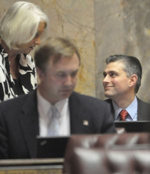 Sen. Mike Baumgartner, R-Spokane, talks with Sen. Randi Becker Friday on the Senate floor. (Jim Camden, Spokesman-Review)